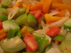 Sauteed bell and anaheim chile peppers, onions, garlic, tomatillos, and tomatoes