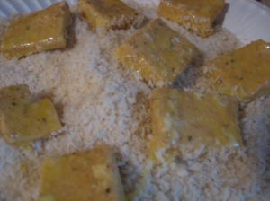 tofu, dipped in flour and egg, ready to be rolled in panko